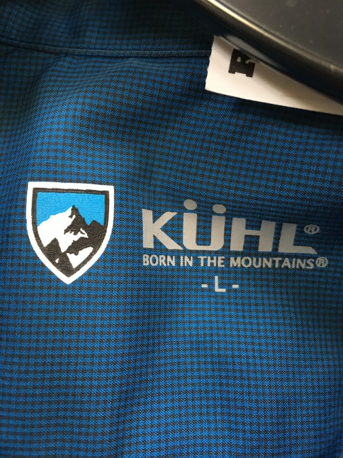 Kuhl label on snap button shirt