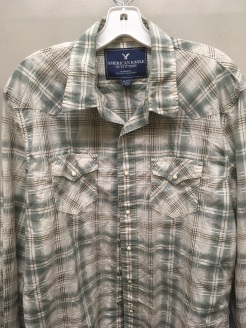 Blue snap button shirt tag