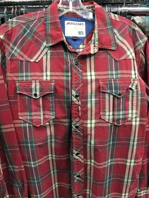 Snap button shirt.