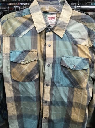Snap button shirt.
