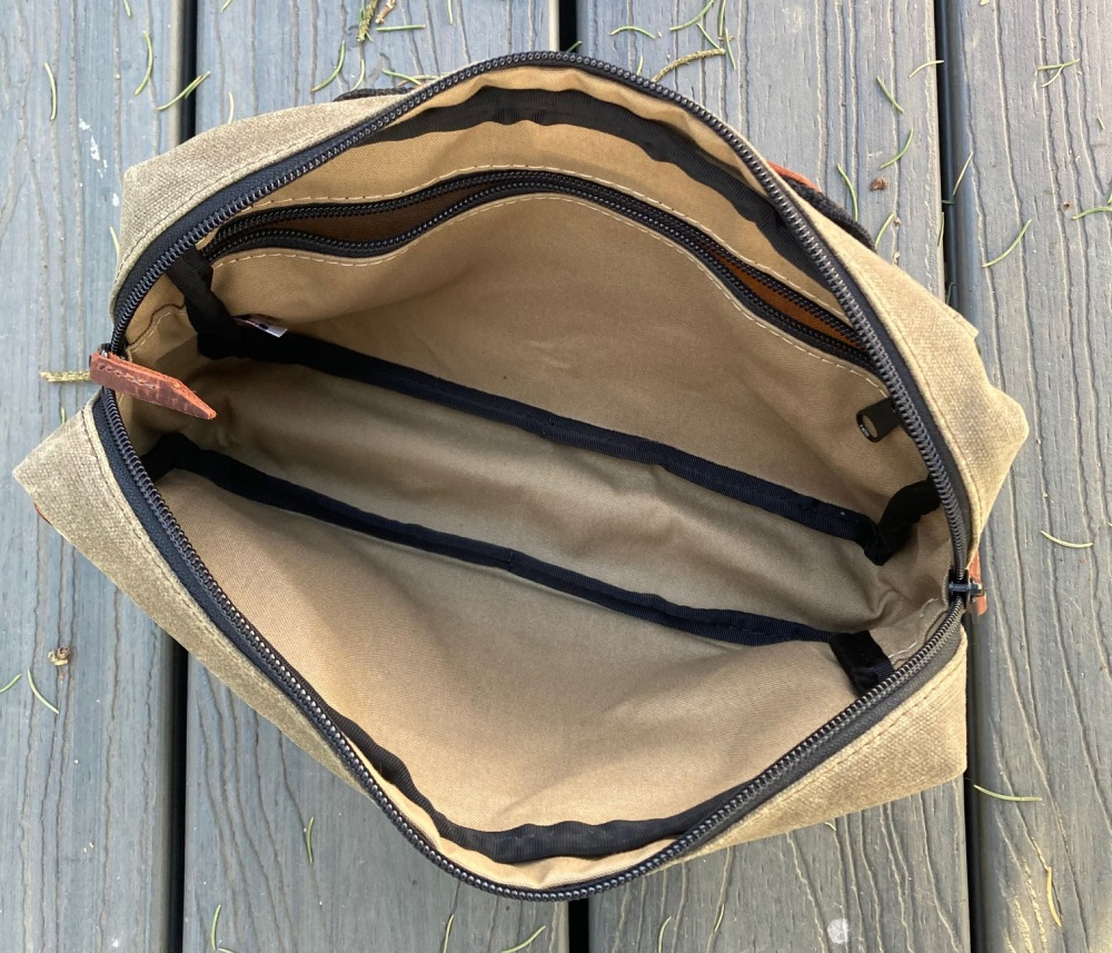 Inside the MBD. Plenty of space for your stuff and an inside zipper pocket to contain smaller items.