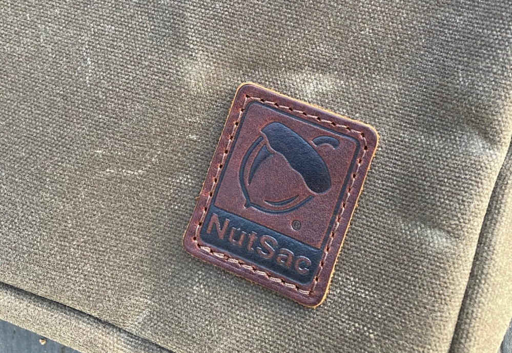 NutSac leather logo patched sewn to the front of the bag.
